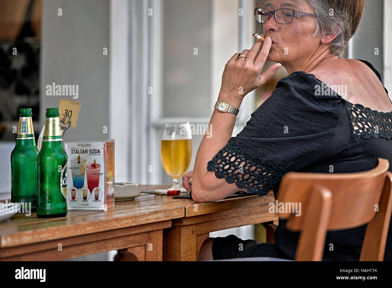 https://c1.alamy.com/comp/HAH1TX/mature-woman-smoking-cigarette-and-drinking-alcohol-HAH1TX.jpg