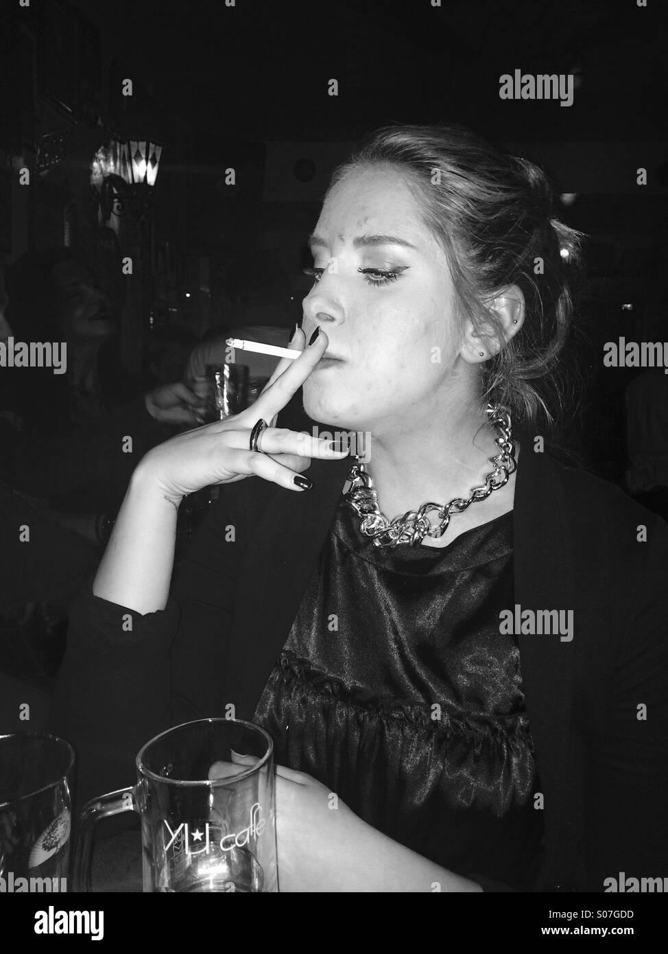 https://c1.alamy.com/comp/S07GDD/girl-smoking-cigarett-S07GDD.jpg