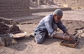making mud bricks by hand before the earthquake 2003 Arg-e-Bam,Iran - Stock Image