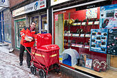 a-royal-mail-postman-continues-his-deliv