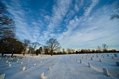 Wide angle view of rows of headstones in Arlington National Cemetery in the snow. Washington DC VA USA US - Stock Image