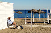 man-tourist-on-mediterranean-empty-beach
