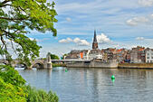 Maastricht view from river Maas or Meuse in calm summer day with small white clouds - Stock Image