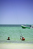 Man and Young woman kite surfing on Holbox island, Quintana Roo, Yucat�n Peninsula, Mexico