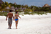 Young couple walking hand in hand on the white sands of Holbox Island, Quintana Roo, Yucat�n Peninsula, Mexico,