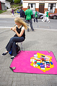 Street vendor selling wool and playing her tin whistle in Dingle, County Kerry, Munster, Republic of Ireland