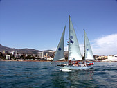 Yacht sailing in the Mediterranean Sea off the coast of Benalmadena Costa, Spain.