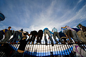 Fans climb the high steel fence around the obelisk on Plaza de La República in Buenos Aires celebrating a 6 - Stock Image