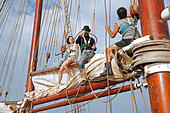 Tourists working on board of the Oosterschelde, three-masted schooner sailing the Atlantic Ocean near Cape Verde / Cabo Verde - Stock Image