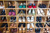 Vintage shoes shop display in a charity shop thrift consignment store - Stock Image