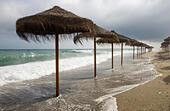 mediterranean-beach-with-parasols-during
