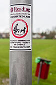 sticker-on-post-advising-dog-owners-to-u
