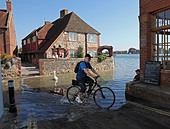 cycling-through-high-tide-at-bosham-chic