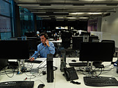 businessman-working-late-in-office-d69m5