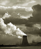 Doel nuclear power plant station in  Belgium. Across River Scheldt estuary. Antwerp in the distance. Dramatic sky - Stock Image
