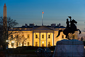 Christmas. The White House w Christmas trees and the equestrian statue of Andrew Jackson in Lafayette Park, Washington - Stock Image