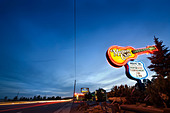 Route 66 in Flagstaff Arizona. Landmark neon sign of the world famous Museum Club Roadhouse at night with light - Stock Image