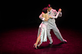 Buenos Aires tango dancers. Couple dancing the tango on stage in La Esquina de Carlos Gardel theater dinner spectacle - Stock Image
