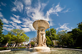 Washington DC, the white marble fountain in Dupont Circle. The statue symbolizes The Sea and is carrying a ship. - Stock Image