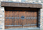Entrance door to a christian building at Heiligenblut, Text means 'Who confesses, will live forever' - Stock Image