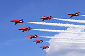 Red Arrows aerobatic team formation flypast at RAF Fairford, UK - Stock Image