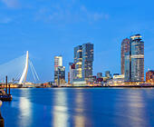 https://c1.alamy.com/thumbs/E6HYB9/rotterdam-skyline-cityscape-erasmus-bridge-and-wilhelmina-pier-docklands-E6HYB9.jpg