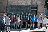 Young students posing, Bread Line, sculpture by George Segal, Room Two of Franklin Delano Roosevelt Memorial, Washington, - Stock Image