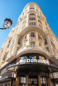 McDonalds restaurant on the corner of Gran Via and Calle de la Montera in Madrid Spain Europe. - Stock Image