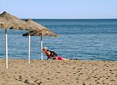 woman-on-mediterranean-beach-in-winter-s