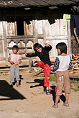 Boys Jumping Rope In A Rural Village Near Phobjikha, Bhutan - Stock Image