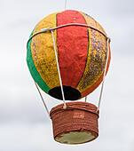A children's handmade paper balloon. - Stock Image