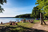blue-lake-trees-swimmers-sunbathers-and-