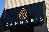 Cannabis dispensary sign above store front, part of expanding network. Ottawa, Canada - Stock Image