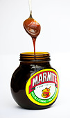 marmite-and-spoon-on-white-background-cn