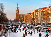 Amsterdam Ice Skating on a frozen Canal in winter. Prinsengracht Canal with Westertoren Tower and Westerkerk - Stock Image