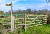 wooden-style-and-gate-to-a-country-field