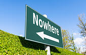 Nowhere concept. Signpost with 'nowhere' and a direction arrow. - Stock Image