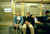 men-asleep-on-a-train-tokyo-japan-b2kddd
